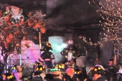 Firefighters attempting to make re-entry into the structure.