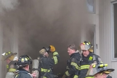 Interior crews muster at the door steps waiting word to return inside