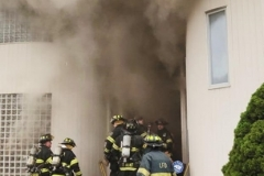 Firefighters attempting to make an additional interior attack, but were held back by reports of further floor collpases