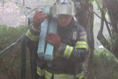 Firefighter Bent streching an additional 1 3/4 line for operations