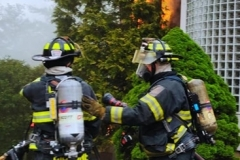 Firefighters Ciccone and Melhorn preparing for an exterior operation