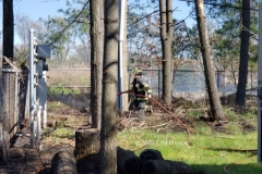 Firefighter Ciccone seen utilizing a booster line to contain the fire