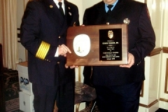 Chief Mullin Recongizing Craig Parker for his dedicated service as Deputy Chief at an Inspection Dinner