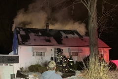 Smoke can be seen venting from the eaves of the roof during operations
