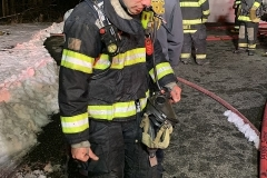 Lt. Kedrie exiting the structure post operation on the first line into the structure.